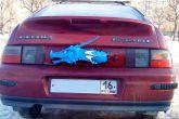 голова дракона на заднем катафоте ВАЗ 2112