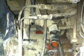 Открутить болты крепления термостата